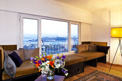 Living room with the view. Living room with a panoramic view of Bosphorus, Hagia Sophiat and Topkapi Palace in Istanbul Royalty Free Stock Photo