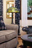 Living Room View One. Cozy contemporary living room showing Leaded glass lamp Royalty Free Stock Photos