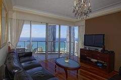 Living room view to ocean and city from top floor luxury apartment