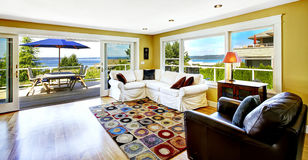 Living room with walkout deck and bay view. Tacoma real estate, Stock Photo