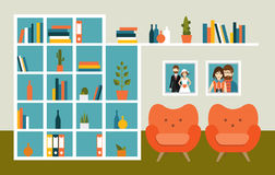 Living room wall with orange armchairs and book shelves. Royalty Free Stock Images