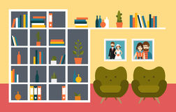 Living room wall with orange armchairs and book shelves. Royalty Free Stock Photo