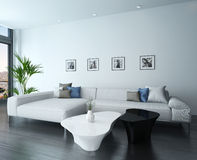 Living room with white couch and portraits on wall Stock Photography