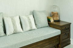 Living room with white and gray pillows on wooden sofa Stock Photo