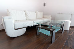 Living room with white leather sofa royalty free stock photos