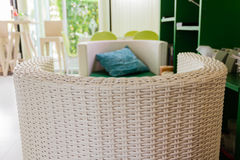 Living room. White rattan armchair in the living room Royalty Free Stock Image