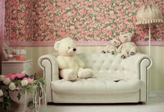 Living room with white sofa teddy bear lamp and fowers royalty free stock photos