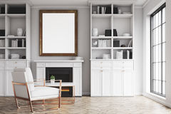 Living room with white walls and an armchair Stock Photos