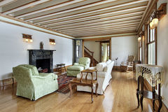 Living room with wood trimmed ceiling Stock Photo