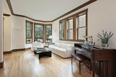 Living room with wood trimmed windows Stock Photo