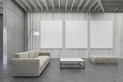Living room with wooden walls, pictures and sofa. Living room interior with wooden walls, a sofa, a rectangular coffee table, three posters and two pouffes. 3d royalty free illustration