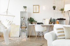 Living room with workspace. Scandi and boho living room with workspace Stock Image