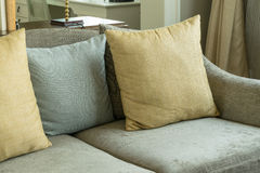Living room with yellow and gray pillows on sofa Stock Photography