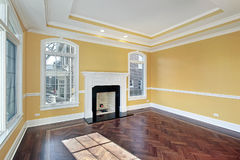 Living room with yellow walls Royalty Free Stock Image