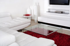 Living space with white leather couch Stock Photo
