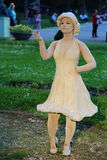 Living statue - attractive young woman Royalty Free Stock Images