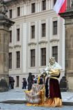 Prague, Czech Republic, January 2015. Living statue of the Czech king in the courtyard of the royal palace. royalty free stock photography
