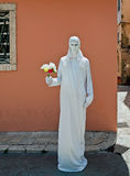 Living statue with flower boquet Royalty Free Stock Photography