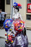 Living statue - girl in the image of a soccer fan Stock Images