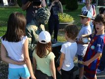 Living statue - giving autographs to children stock video footage