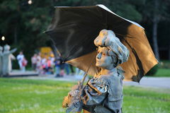Living statue - lady with umbrella Royalty Free Stock Photography