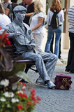 Living statue - The man in the image of the artist Stock Images