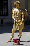 Living statue - a man in the image of Cupid Royalty Free Stock Photo