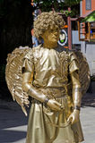 Living statue - a man in the image of Cupid Royalty Free Stock Image