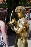 Living statue - a man in the image of Cupid Royalty Free Stock Images
