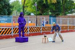 Living statue perform in front of Tokyo Metropolitan Art Museum in Ueno Park in Tokyo, Japan. Tokyo, Japan - October 19, 2016 : Living statue perform in front Royalty Free Stock Photos