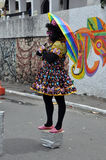 Living statue with rainbow parasol Royalty Free Stock Photos