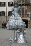 Living statue of woman with flower Stock Photo