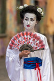 Living statue of a woman japanese dressed. TIMISOARA, ROMANIA - MARCH 31, 2017: Living statue of a woman, dressed traditional japanese and present on the street Royalty Free Stock Photography
