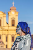 Living statue of a woman multicolor dressed. TIMISOARA, ROMANIA - MARCH 31, 2017: Living statue of a woman, multicolor dressed and present on the street inside Stock Photos