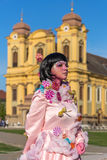 Living statue of a woman multicolor dressed. TIMISOARA, ROMANIA - MARCH 31, 2017: Living statue of a woman, multicolor dressed and present on the street inside Stock Photography