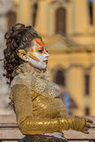 Living statue of a woman multicolor dressed. TIMISOARA, ROMANIA - APRIL 1, 2017: Living statue of a woman, multicolor dressed and present on the street inside Stock Photography