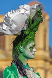 Living statue of a woman multicolor dressed Royalty Free Stock Photography