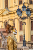 Living statue of a woman multicolor dressed Royalty Free Stock Photos