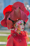 Living statue of a woman multicolor dressed Royalty Free Stock Images
