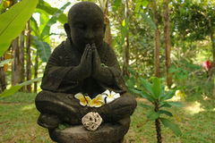 The Living stone. Indonesia. Bali. Sculpture of a monk in the yard. The Living stone Stock Photos