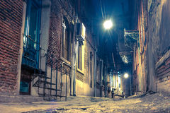 Living street in old city at night Stock Photography