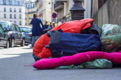 Living on the street. The possessions of a homeless person on the street in Paris Stock Image