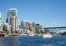 Living in Vancouver. Condominium buildings and a marina are facing False Creek, a short inlet in the heart of Vancouver, British Columbia, Canada.  False Creek Stock Photo