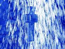 Living water - Cross under shower royalty free stock photo