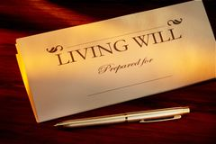 Living Will. With gold pen shot on warm wood desk