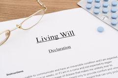 Living will with pills and eyeglasses Stock Image