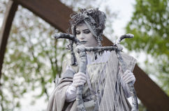 Woman statue. Woman dressed as ancient greek musician holding harp in hands on  May 10, 2014 in Bucharest Royalty Free Stock Images