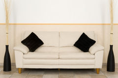 Livingroom. A couch in a livingroom Royalty Free Stock Images