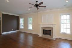 Livingroom with fireplace Stock Photos