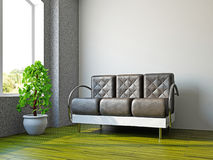 Livingroom with lsofa and a plant Royalty Free Stock Images